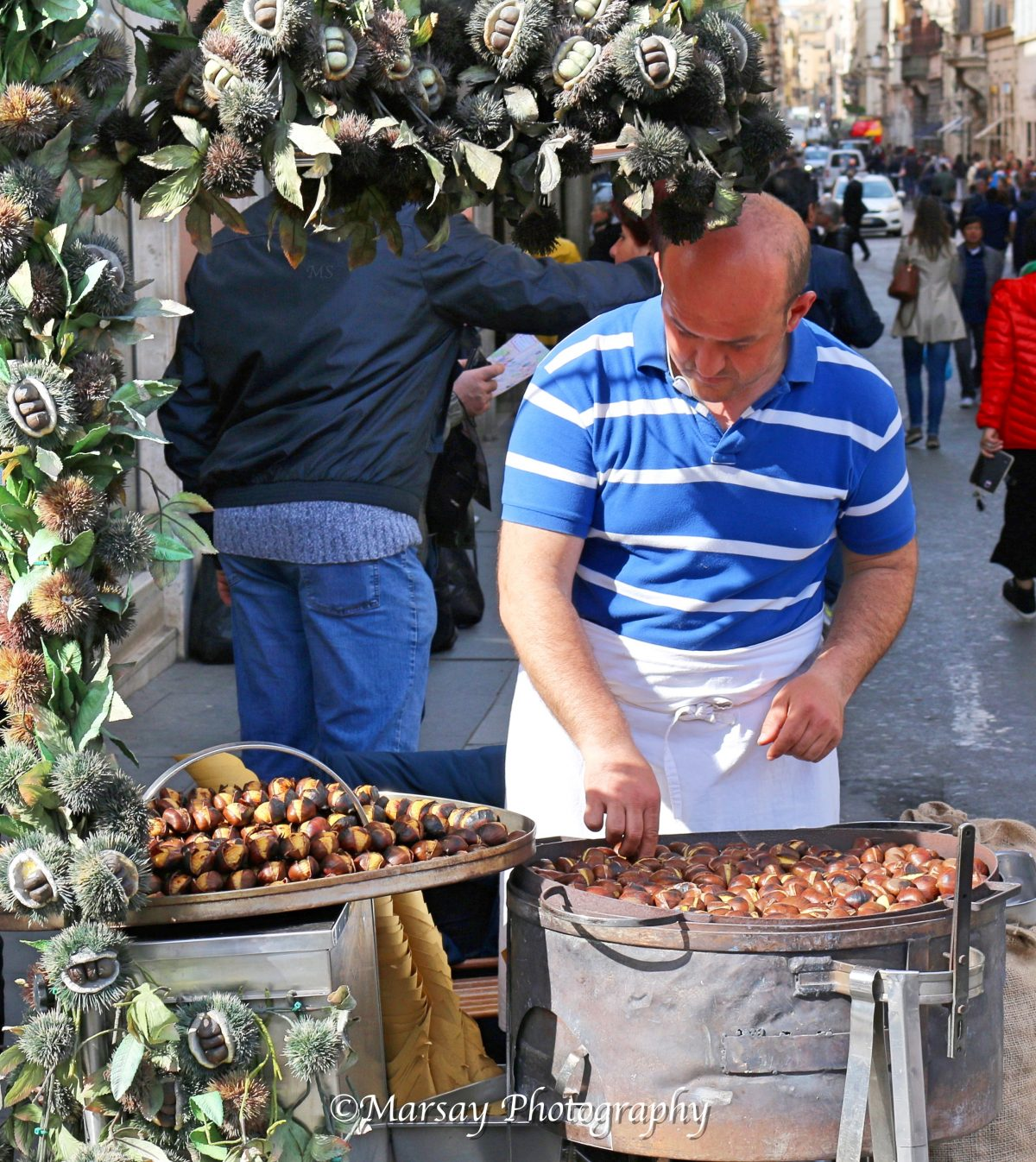 Grab a Snack of Roasted Chestnuts as you carry on exploring more of Rome.