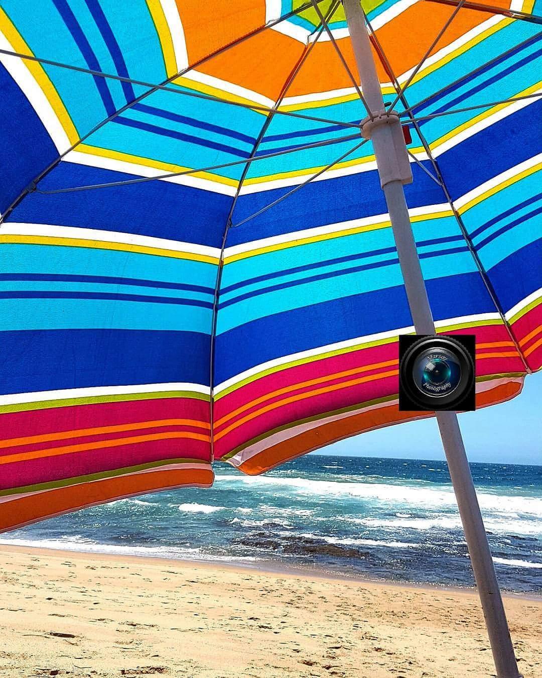 Bidding 2016 goodbye, under a Brightly coloured  umbrella. Durban, December 2016.